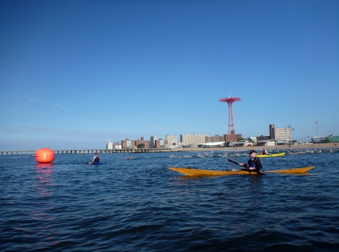 Kayaker's-eye view. Terry in my favorite boat with the Grimaldo's Mile swimmers coming out to round first buoy behind him